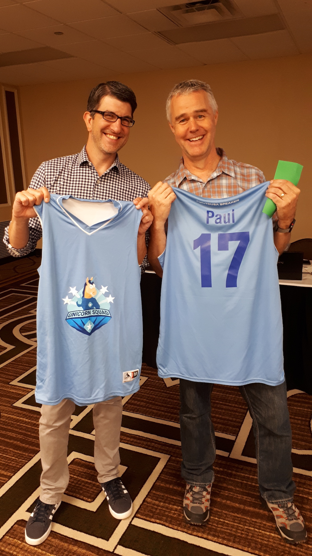 Speakers Damian Synadinos and Paul Holland happy about their speaker gift at Agile Testing Days USA 2019